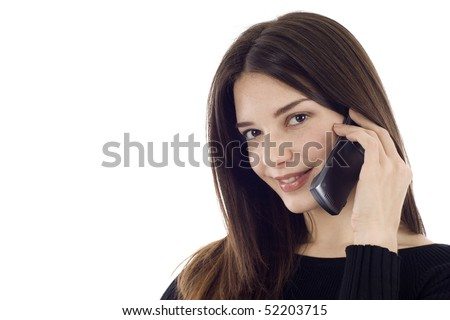 Friendly smiling woman on the phone, she's looking at the the camera, a lot of copyspace - stock photo
