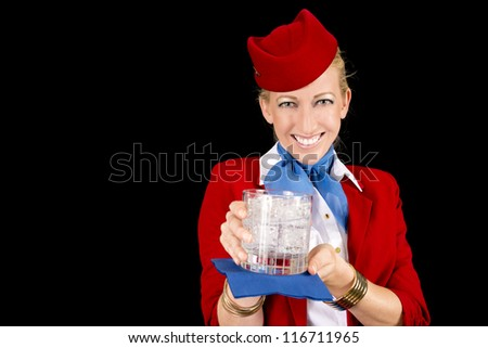 Friendly Stewardess Bringing a Welcoming Beverage. - stock photo