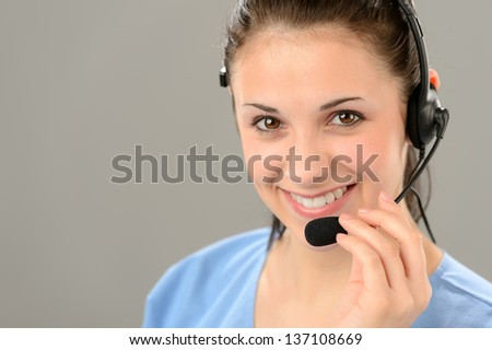 Friendly support phone operator woman wearing headset