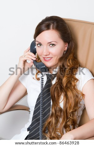 friendly telephone operator in an office environment. - stock photo
