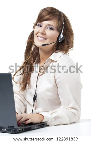 Friendly telephone operator with headset laptop on a white background - stock photo