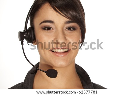 Friendly woman with a telephone headset, like used in call centers of viop calls. - stock photo
