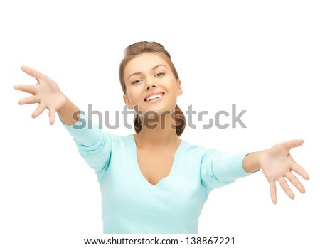 friendly woman with an open hand ready for hugging - stock photo