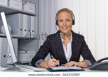 friendly woman with headset in customer service - stock photo