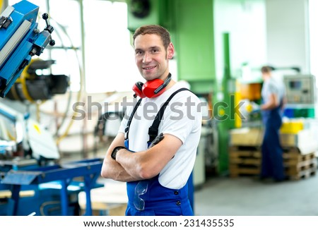 friendly worker in factory - stock photo