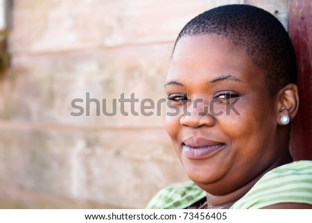Friendly young black african woman close up. - stock photo