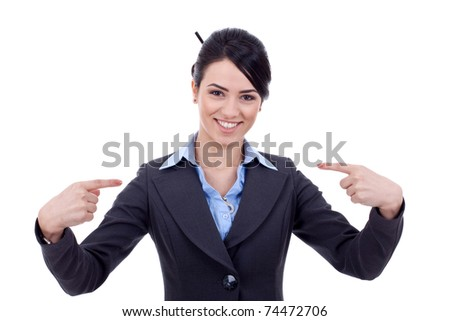 Friendly young business woman pointing at herself - the chosen one - stock photo