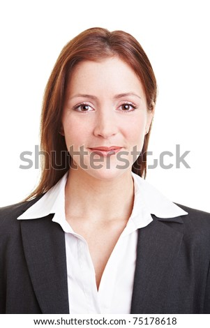 Friendly young business woman smiling into the camera - stock photo