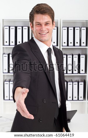 friendly young businessman handshake - stock photo