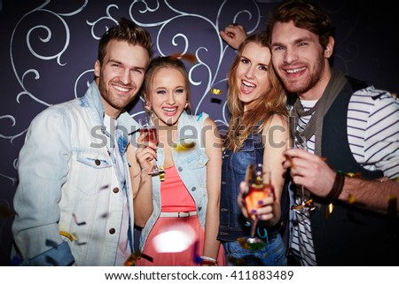 Friendly young clubbers enjoying party