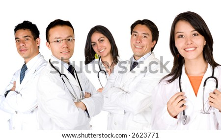 friendly young doctors smiling over a white background - focus is on the female doctor on the right - stock photo