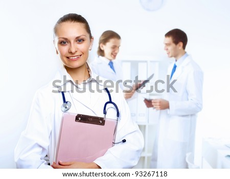 Friendly young female doctor in uniform in medical office
