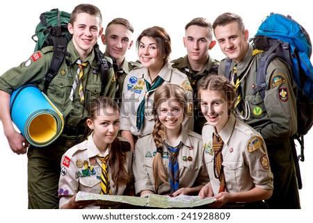 Friendly young scouts in uniform embracing together isolated on white background - stock photo