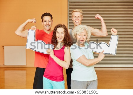 Friends and senior showing their muscles at fitness center