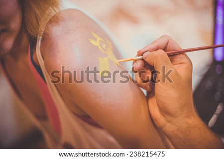 Friends are painted and ready to party. - stock photo