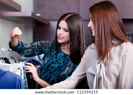 Friends are searching for a wonderful dress - stock photo