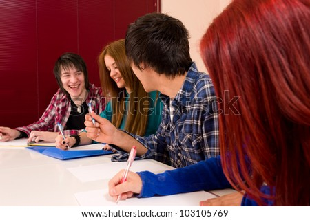 Friends  at college, a relaxed fun atmosphere - stock photo