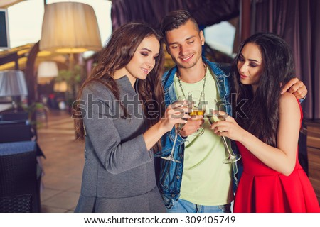 Friends at party drinking cocktails and having fun - Three tourists drinking aperitif in a restaurant