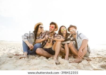 Friends at the beach enjoying the summer - stock photo