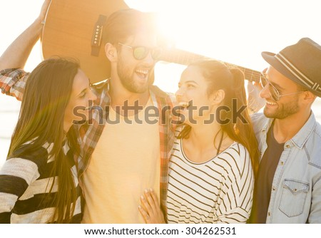 Friends  at the beach having fun together  - stock photo