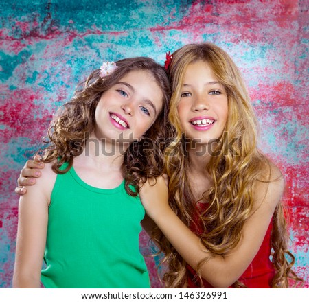 friends beautiful children girls hug together happy smiling on grunge background - stock photo