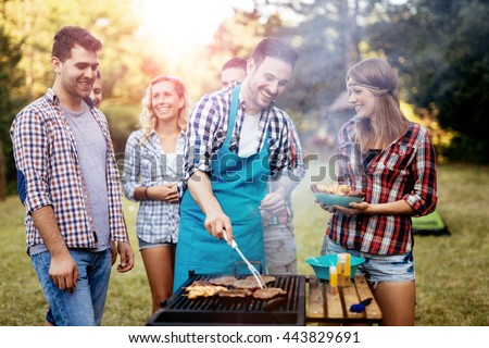 Friends camping and having a barbecue in nature - stock photo
