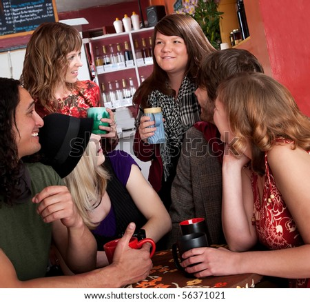 Friends catching up with each other at a cafe - stock photo