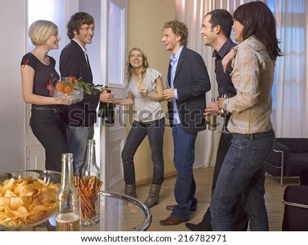 Friends celebrating with food and drinks. - stock photo
