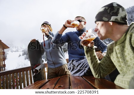 Friends Chugging Beer - stock photo