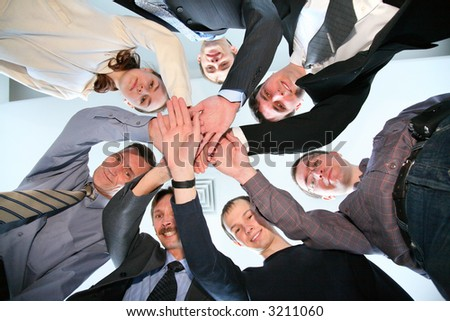 friends circle with hands 2 - stock photo