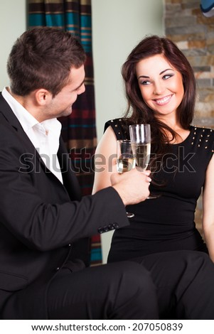 friends clinking sparkling wine glasses at a party  - stock photo