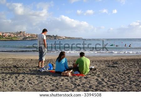Friends down the beach - stock photo