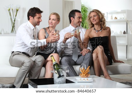 Friends drinking champagne - stock photo