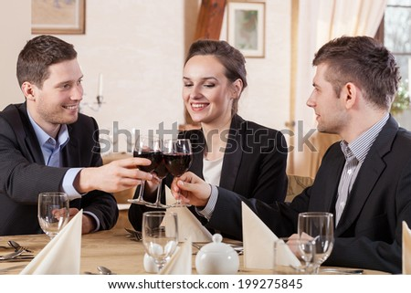 Friends drinking wine in a restaurant, horizontal - stock photo