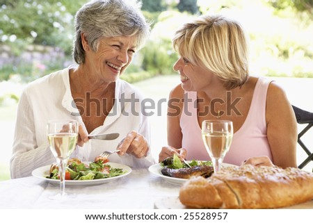 Friends Eating An Al Fresco Lunch, Holding Wineglasses