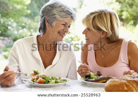 Friends Eating An Al Fresco Meal - stock photo