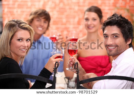 Friends eating in a restaurant - stock photo