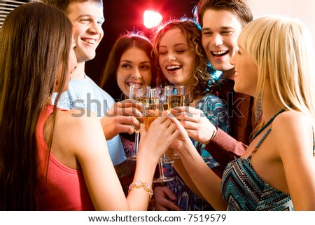 Friends enjoying a celebratory drinks of champagne - stock photo