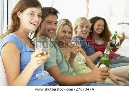 Friends Enjoying A Drink Together - stock photo