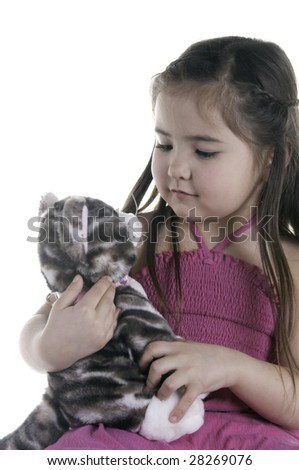 Friends for life: cute girl of five holding her teddy cat - stock photo