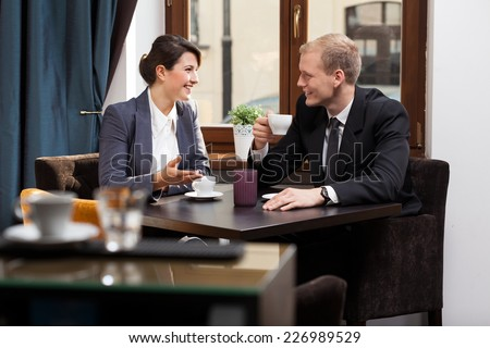 Friends from work drinking coffee after job - stock photo