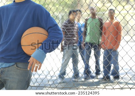 Friends Gathering at Basketball Court - stock photo