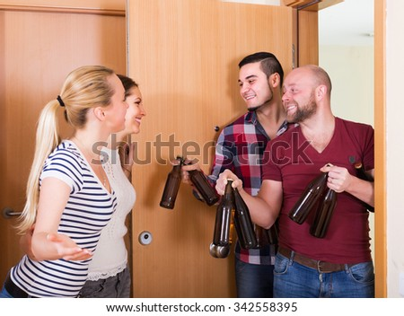 Friends gathering together at house booze party - stock photo