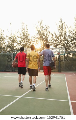 Friends going back home after basketball game - stock photo