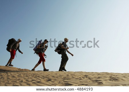 Friends going up along hill in mountain - stock photo
