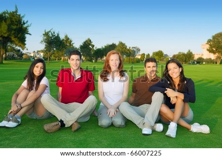 friends group people happy sitting green grass outdoor - stock photo