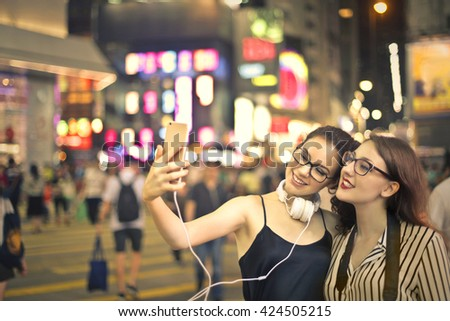 Friends hanging out at night - stock photo