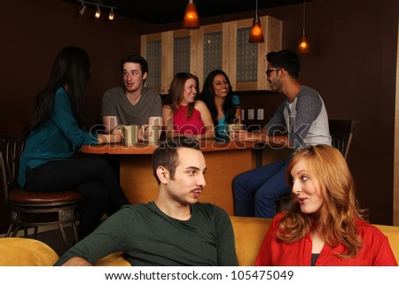 Friends Hanging out at the Cafe - stock photo