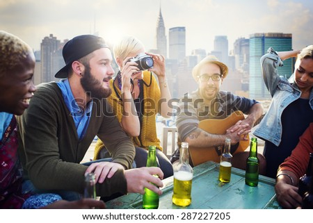 Friends Hanging out Holiday Rooftop Happiness Concept - stock photo
