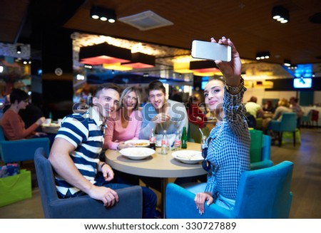 friends have lanch break in shopping mall, eating italian fast food - stock photo